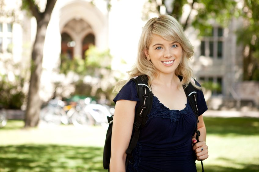 Smiling blonde college girl