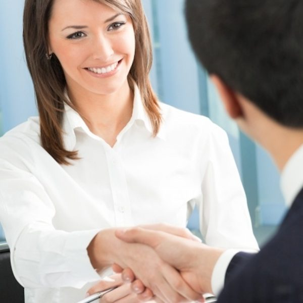 woman smiling and shaking hands