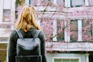 Girl with backpack on campus