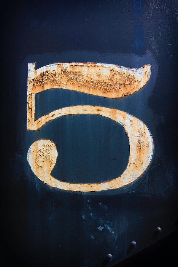 Number 5 on blue field